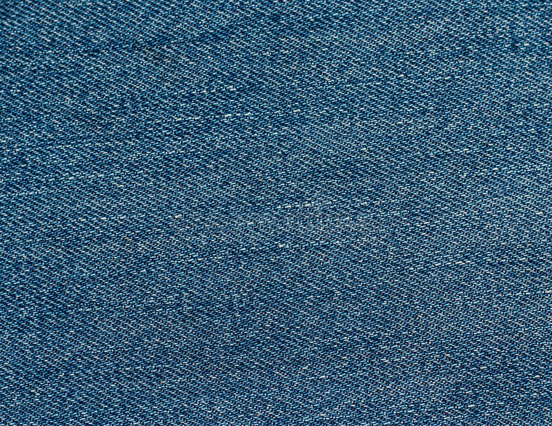 Blue jeans fabric royalty free stock images