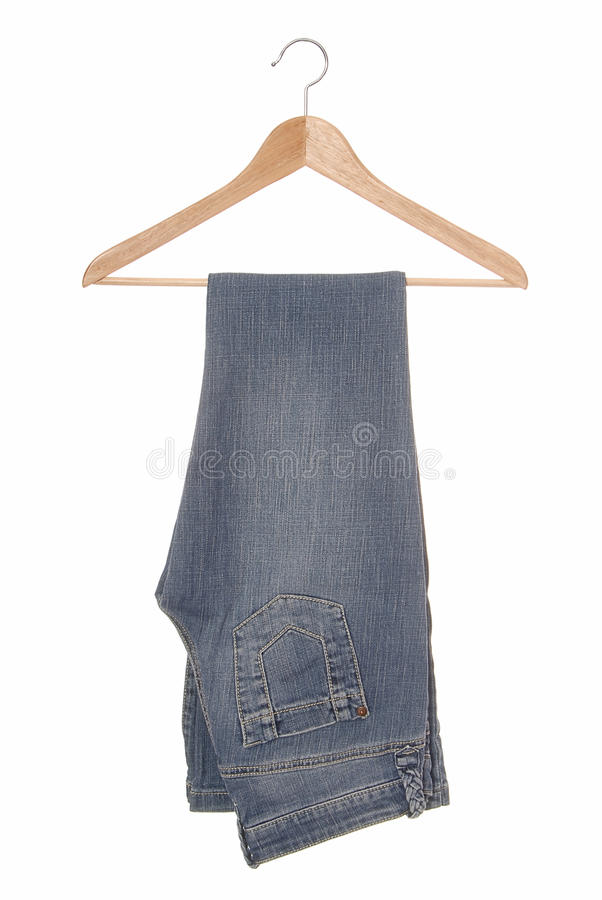 A blue jeans are on hanger. royalty free stock photo