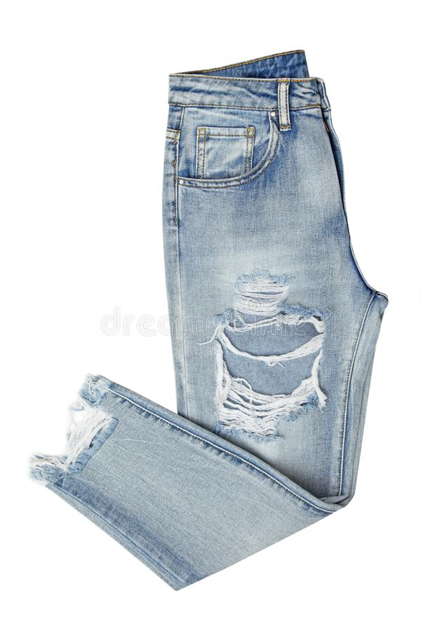 Blue jeans with holes folded in two isolated on white background. Fashion object stock image