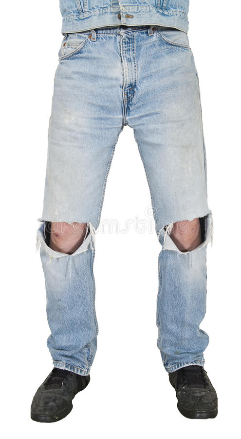 Blue Jeans, Holes in Knees, Grunge Look Isolated. Grunge or grungy look with old clothes that are faded blue jeans look with holes in the knees. The old clothes royalty free stock image