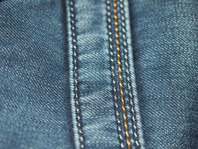 Blue jeans. Pocket on blue jeans for backgrounds and textures stock photo
