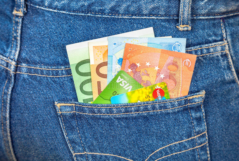Blue jeans pocket with euro notes and credit cards royalty free stock photo
