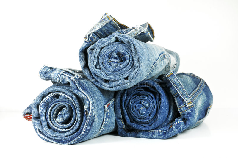 Blue jeans rotolate immagine stock