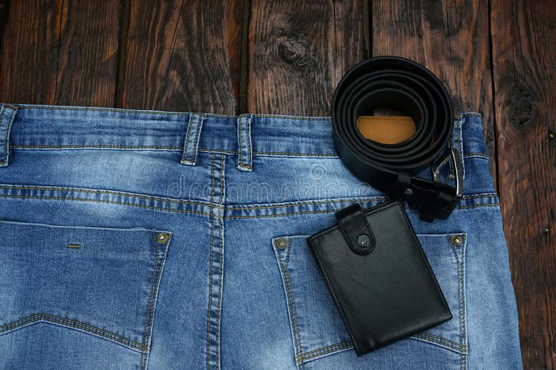 Blue jeans on a rough, wooden table. stock photography