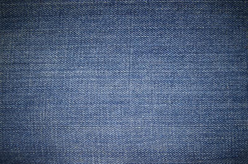 Blue jeans texture. The dark blue jeans texture stock images