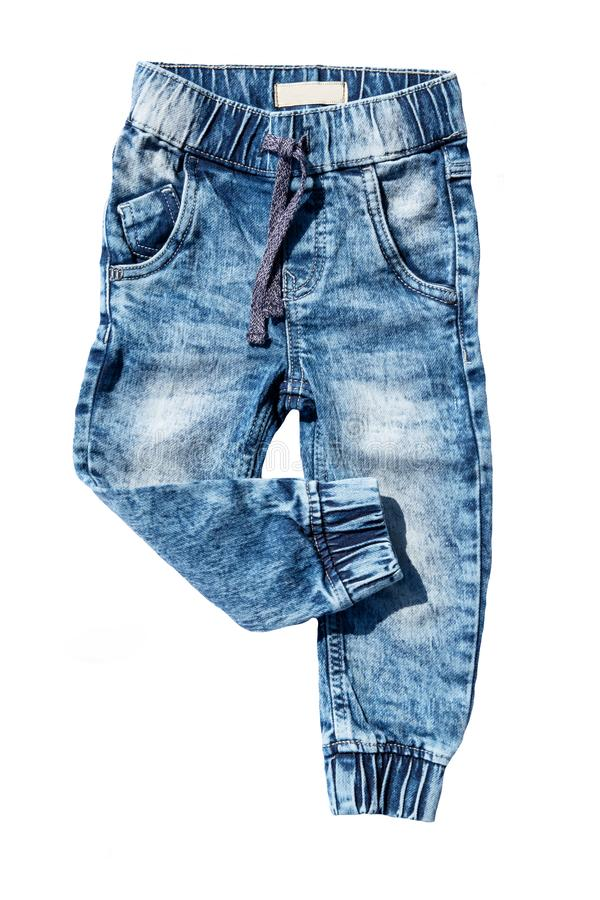 Blue jeans trouser isolated on white background. Fashionable jeans for child boy. Right trouser leg folded. Top view front. royalty free stock photo