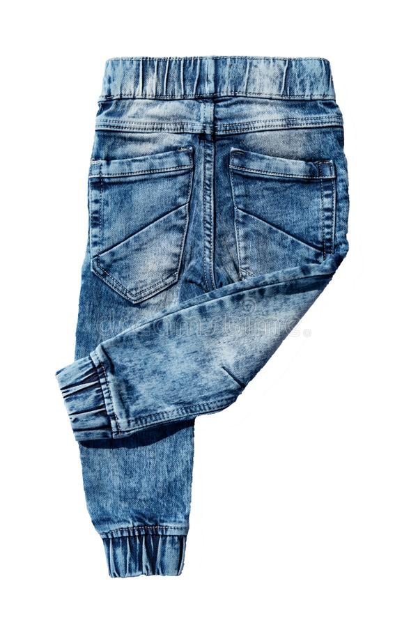 Blue jeans trousers isolated on white background. Fashionable jeans for child boy. Right trouser leg folded. Top view on back. Blue jeans trousers isolated on royalty free stock photography