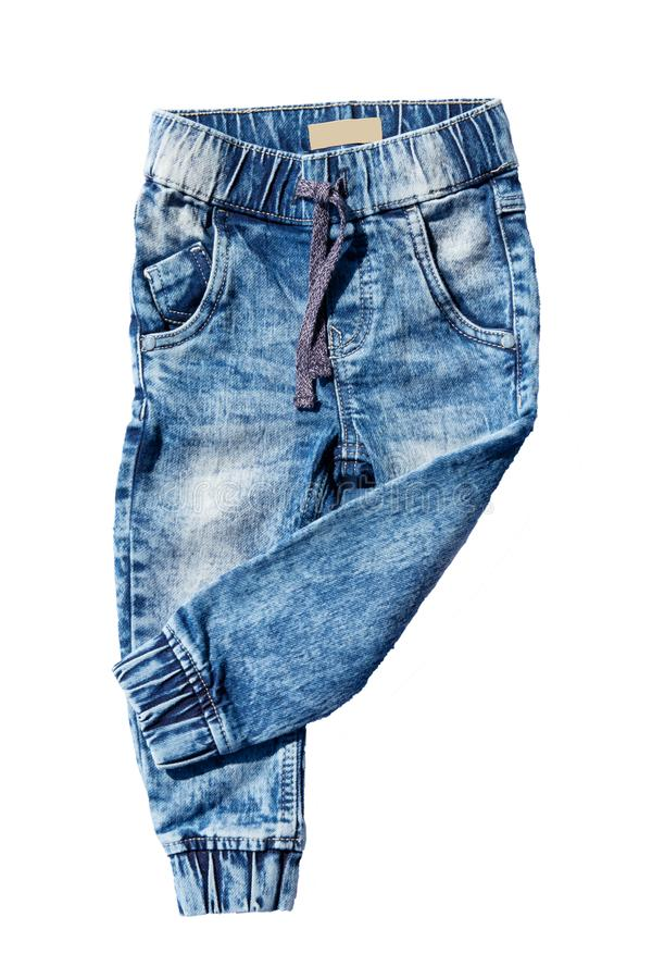 Blue jeans trousers isolated on white background. Fashionable jeans for child boy. Left trouser leg folded. Top view front. royalty free stock image