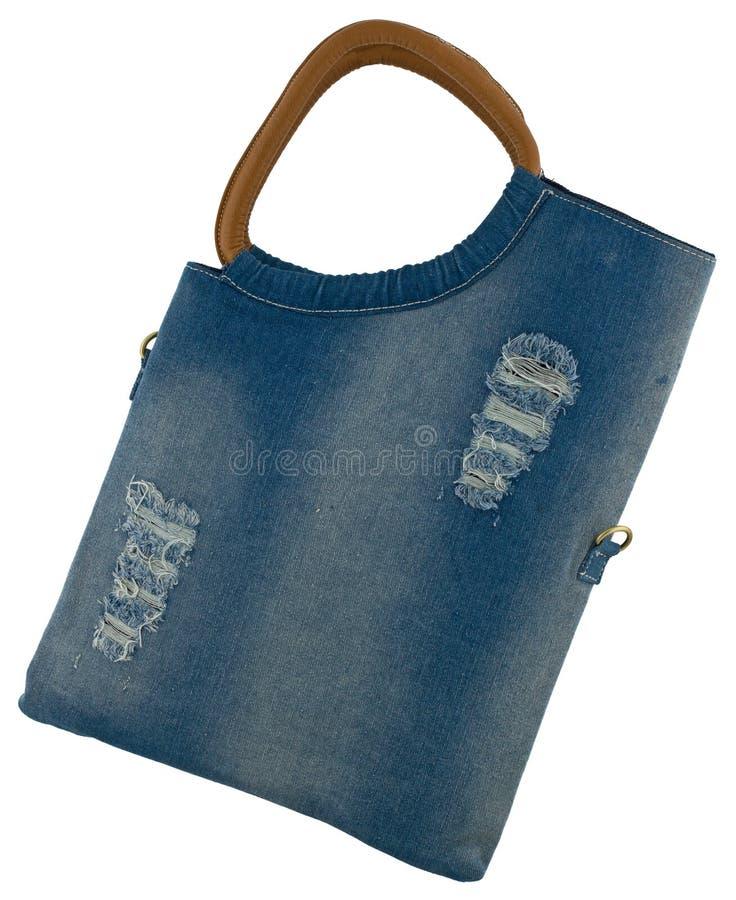 Blue Jeansfrauenbeutel am weißen Hintergrund lizenzfreie stockfotos
