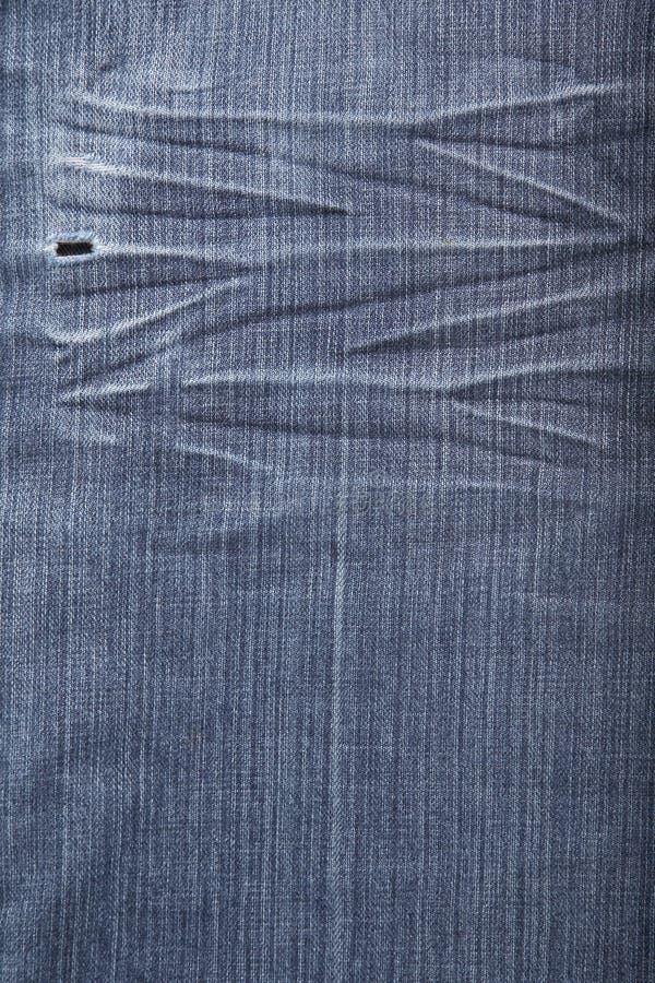 Blue Jeanshintergrund stockbilder