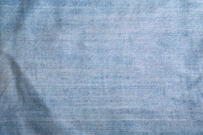 Blue Jeanshintergrund lizenzfreie stockbilder
