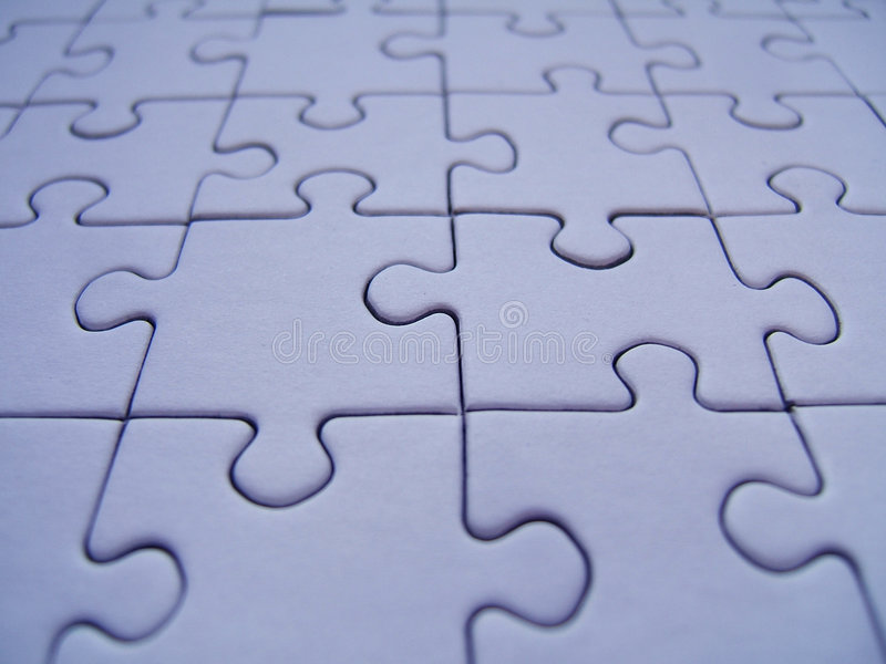 Blue jigsaw. Blue puzzle pattern royalty free stock image