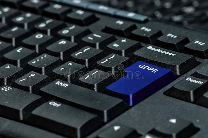 Blue keyboard key with text GDPR as symbol for Privacy and General Data Protection Regulation on a notebook computer.  stock photography