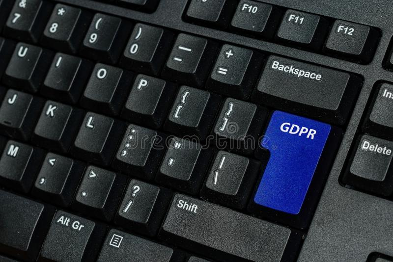 Blue keyboard key with text GDPR as symbol for Privacy and General Data Protection Regulation on a notebook computer.  stock photo