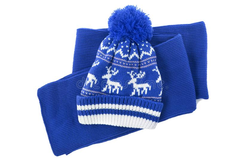 Blue knitted scarf winter clothes bobble hat isolated white background royalty free stock photography