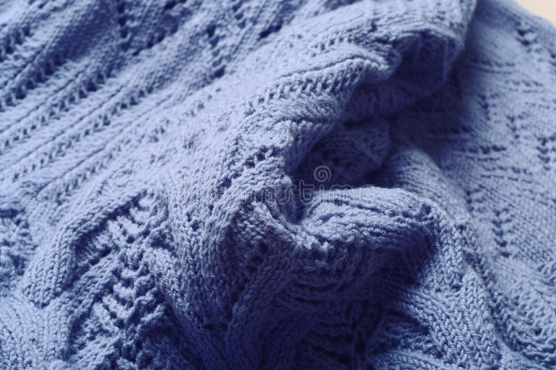 Blue knitted woolen stock photography