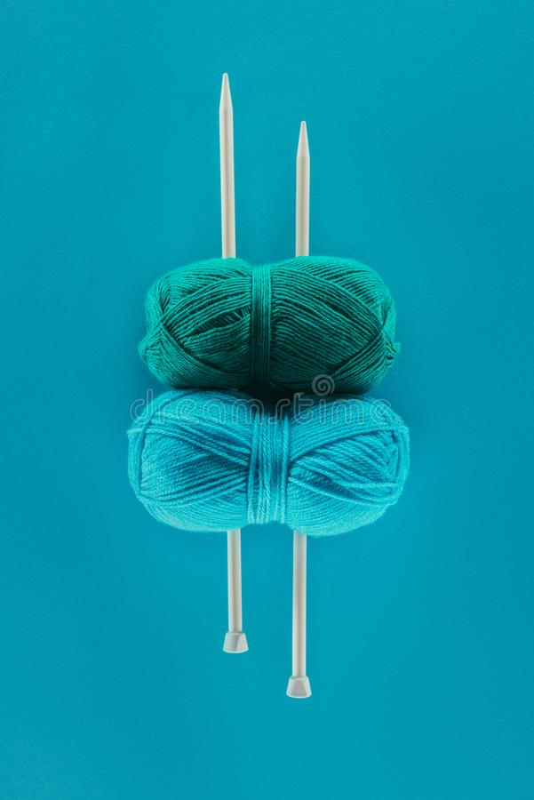 top view of blue knitting yarn with knitting needles royalty free stock images