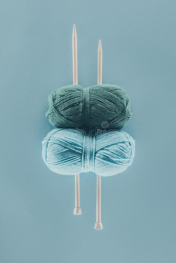 top view of blue knitting yarn with knitting needles stock photo