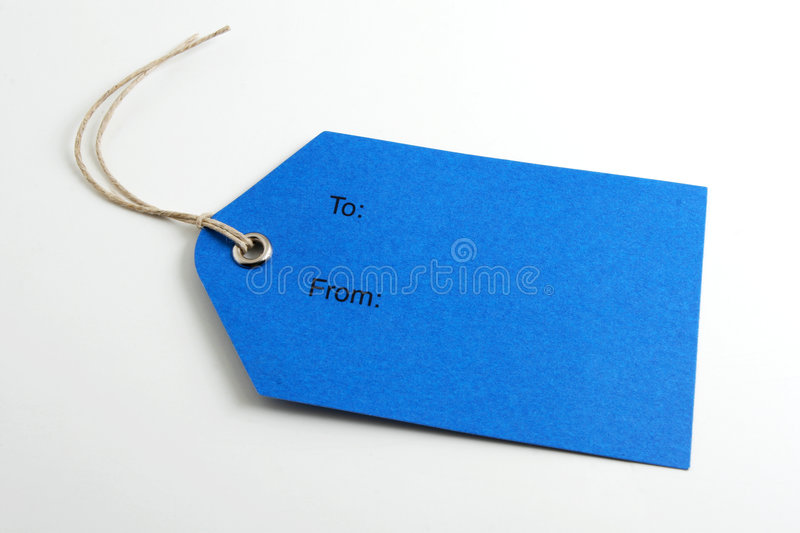 Blue label. Close up of a blank gift tag on white background royalty free stock photography