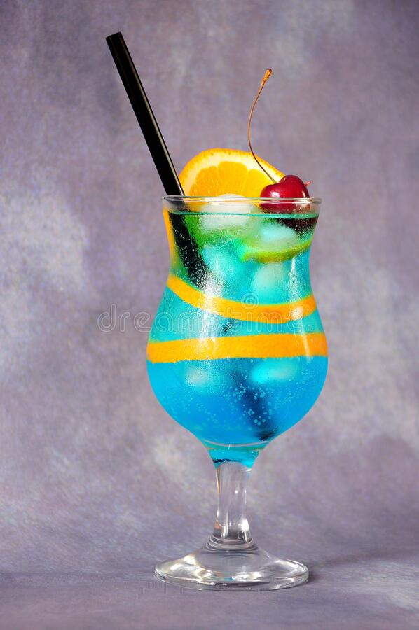 Free Blue Lagoon Cocktail, A Tall Glass With A Drink, Ripe Cherries, A Slice Of Orange And A Straw On A Gray Background Royalty Free Stock Photo - 191130955