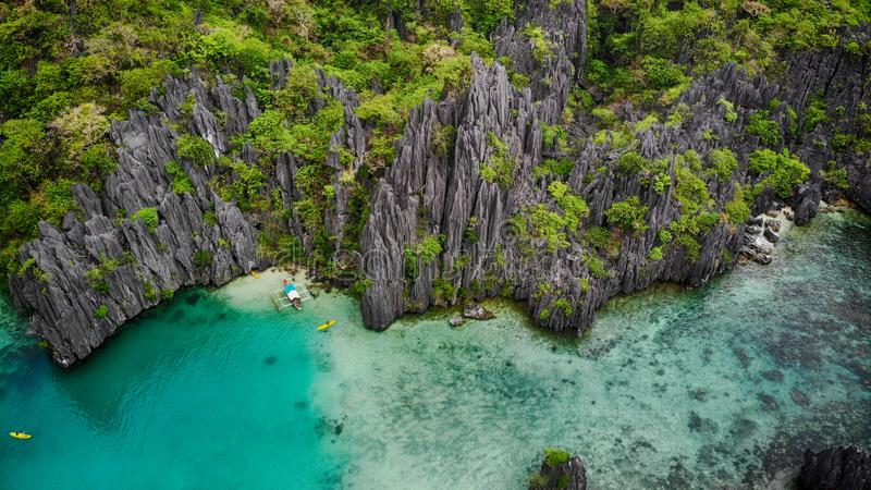 Blue lagoon and karst mountains, view from the top. Palawan, Philippines royalty free stock photography