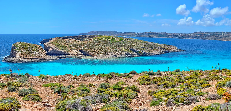 Blue Lagoon of Maltese islands. A view over the Blue Lagoon in Comino on the Maltese Islands in the Mediterranean sea, Malta. Archipelago, coast, coastal stock image