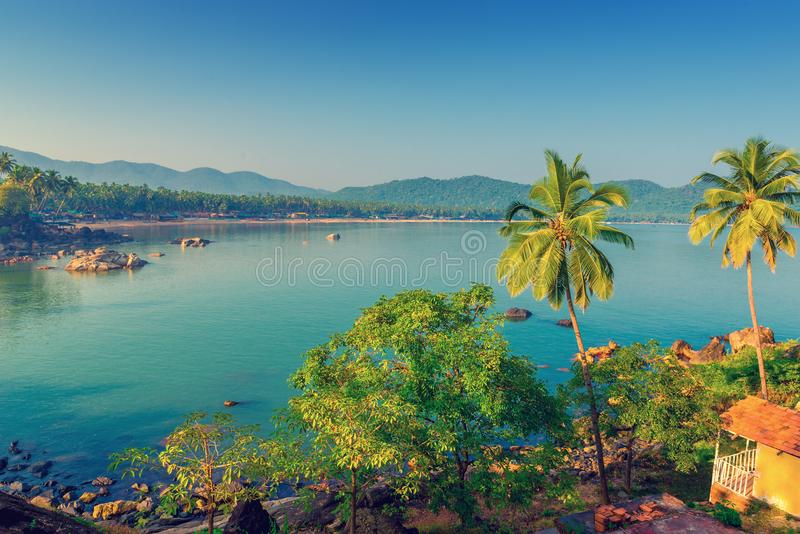 Blue Lagoon and the rising sun in Goa. Tinted royalty free stock image