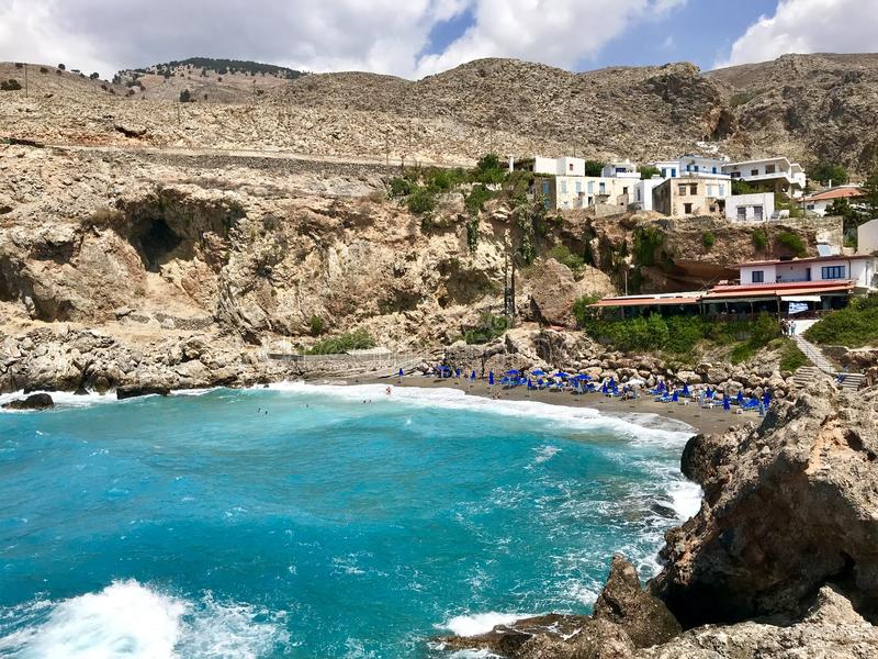 Blue lagoon with transparent water and small beach of Chora Sfakion town at southern part of Crete island, Greece.  royalty free stock photography