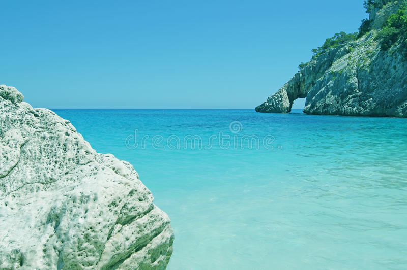 Blue lagoone with cliffs and stone / Cala Goloritze, Sardinia royalty free stock photos