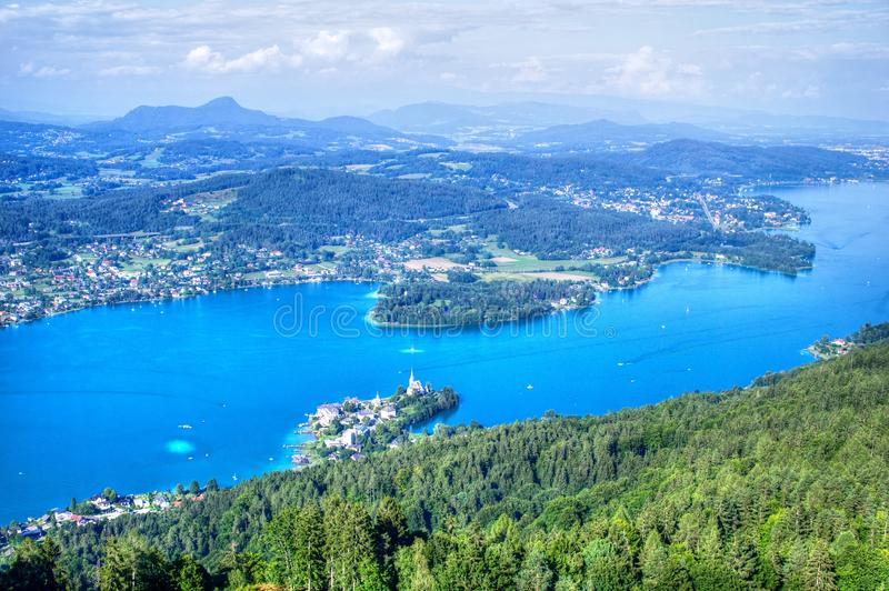 Blue lake in Austrian Alps, aerial view royalty free stock photography