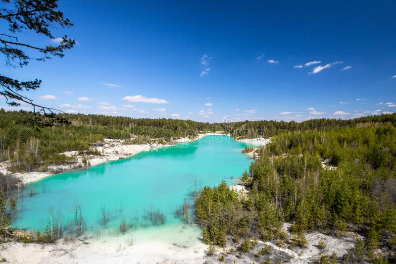 Blue Lake in the forest in clear weather stock image