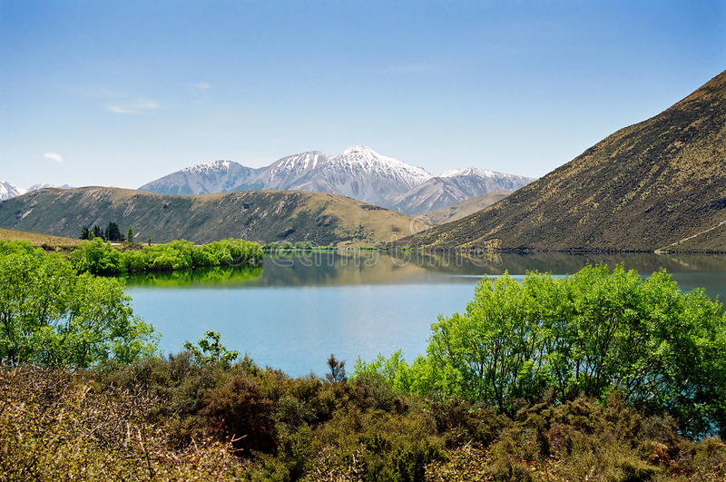 Blue lake and mountain, New Zealand stock photo