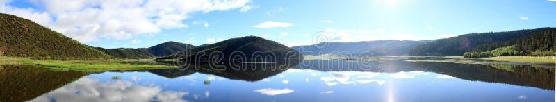 Blue lake and mountains stock photos