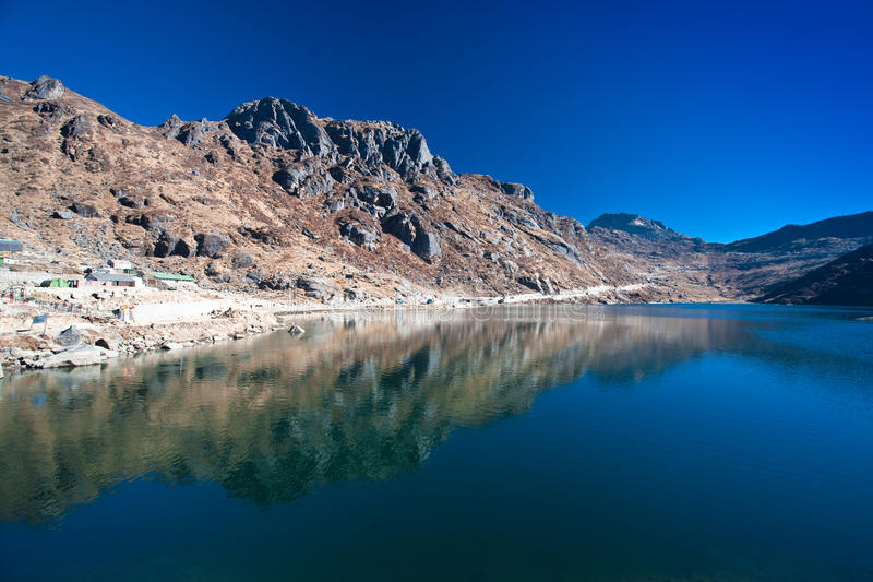 Blue Lake in Sikkim. A Lake surround by rocky hills and blue skies in Sikkim, India. Reflection of the lake is seen on the surface of the water royalty free stock image