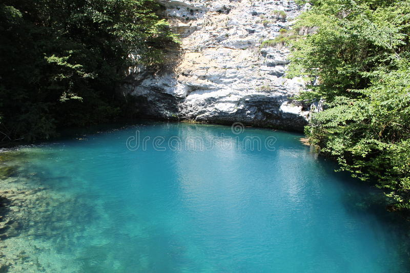 Blue lake and white rocks royalty free stock images