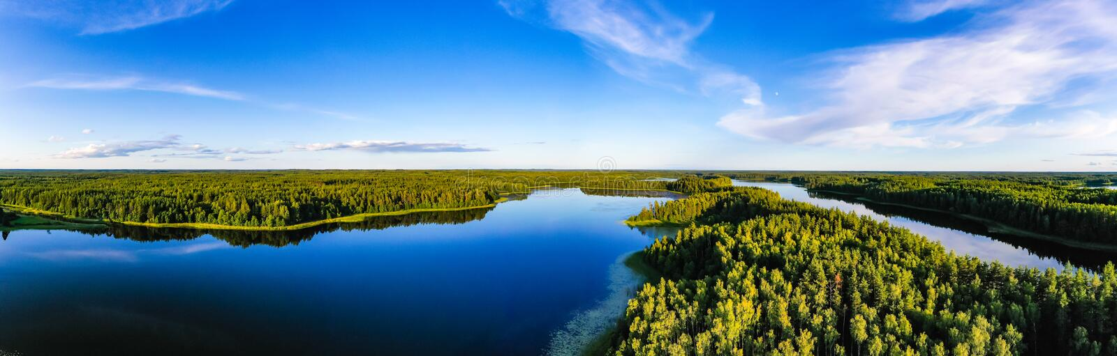 Blue lakes surrounded by green forest, panorama landscape. Ecology concept royalty free stock photography