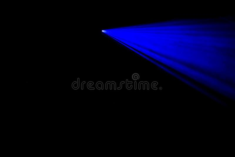 Blue laser beams in the dark royalty free stock photo