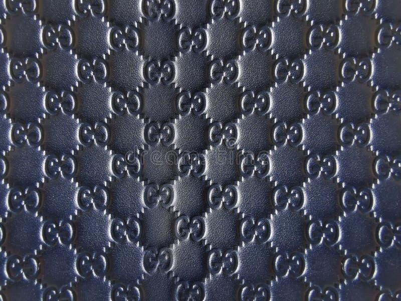 Blue leather background of gucci monogram logo. The image depicts a blue leather background of the repeated gucci monogram logo royalty free stock photography