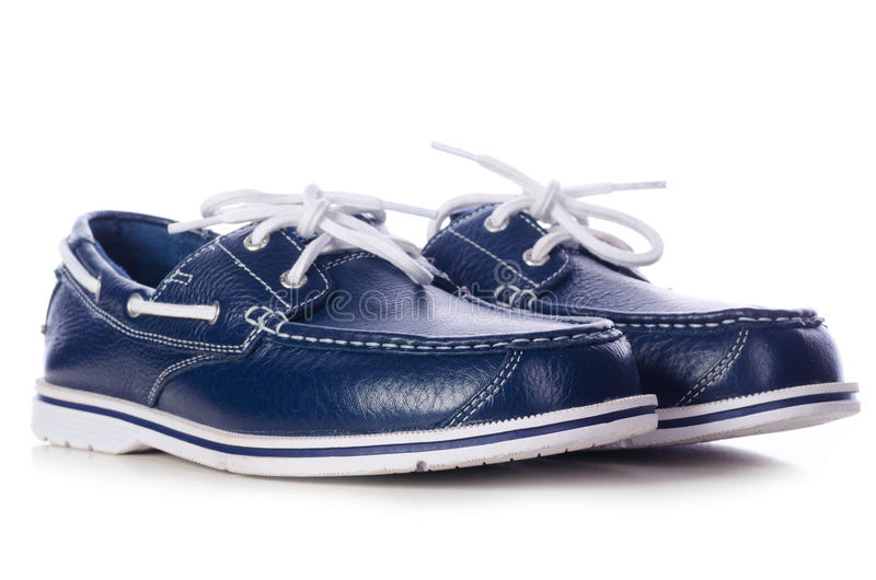 Blue leather deck shoes royalty free stock photography