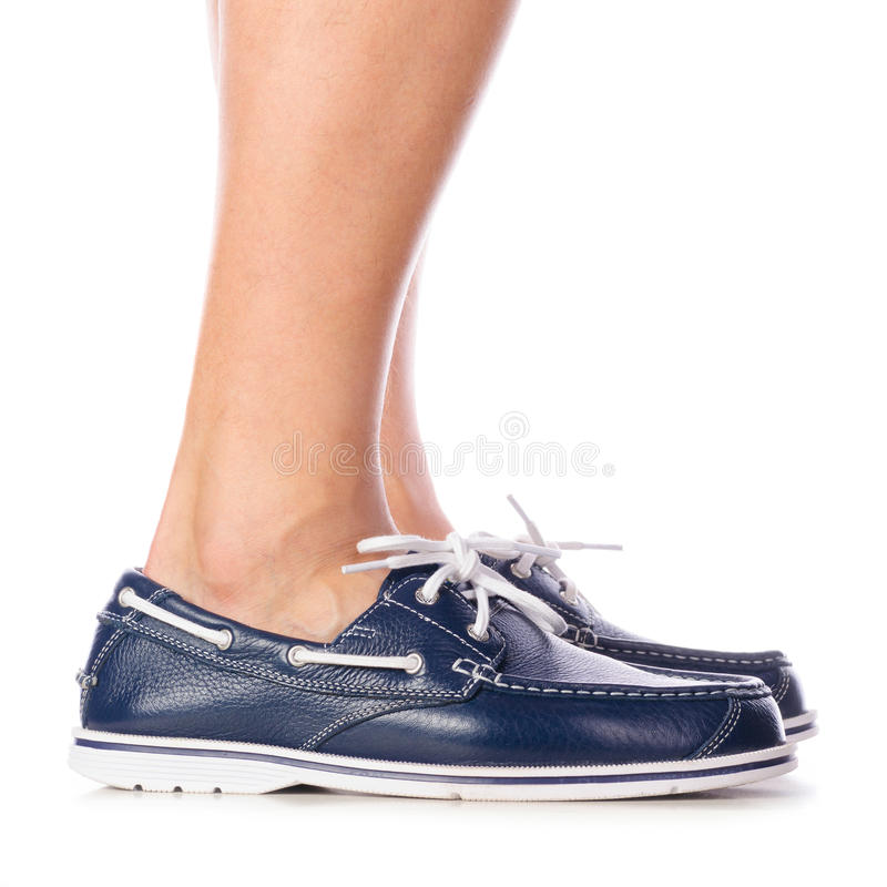 Blue leather deck shoes royalty free stock photos