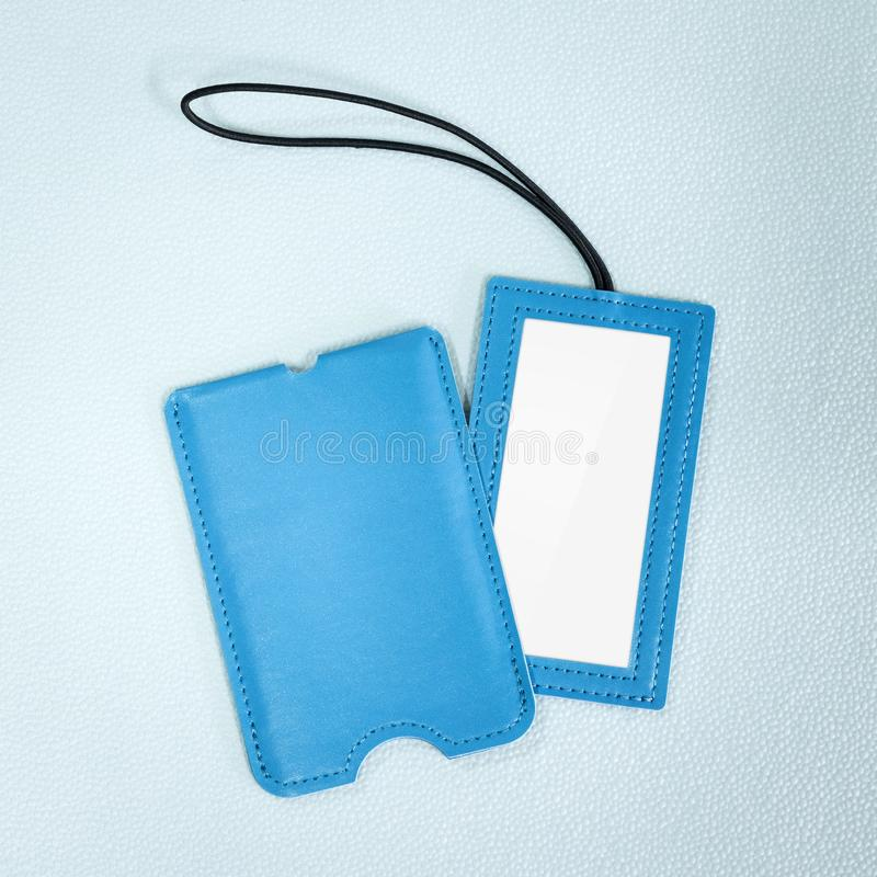 Blue leather hanging tag on synthetic background. Blank name tag for your design stock images