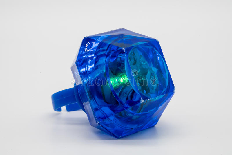 Blue LED plastic diamond ring toy isolated on white. Background stock photos