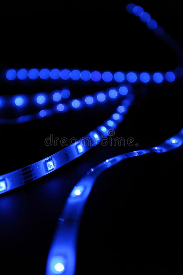 Blue leds. Led blue stripes black background royalty free stock photo
