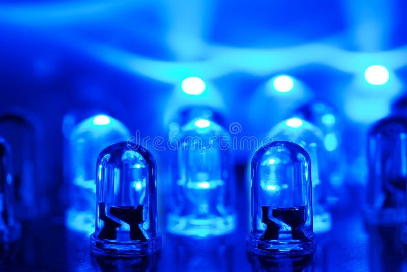 Blue LEDs. LED background with dozens transparent blue LEDs royalty free stock photography