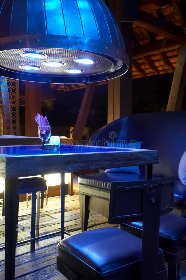 In blue light. Fragment like view of bar interior in mysterious light stock photo
