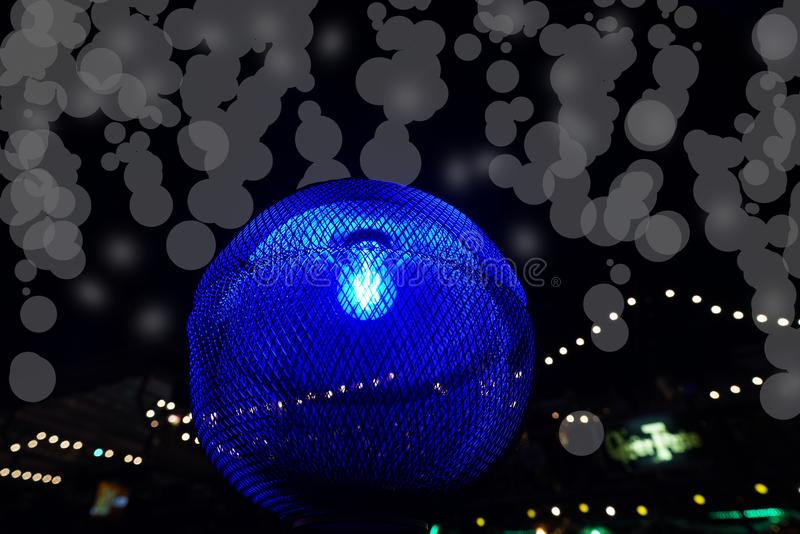 Blue light and bokeh in the dark night. Blue light and bokeh in black night royalty free stock photos