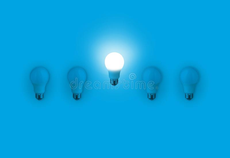 Blue light bulbs with glowing one different idea on blue stock photos