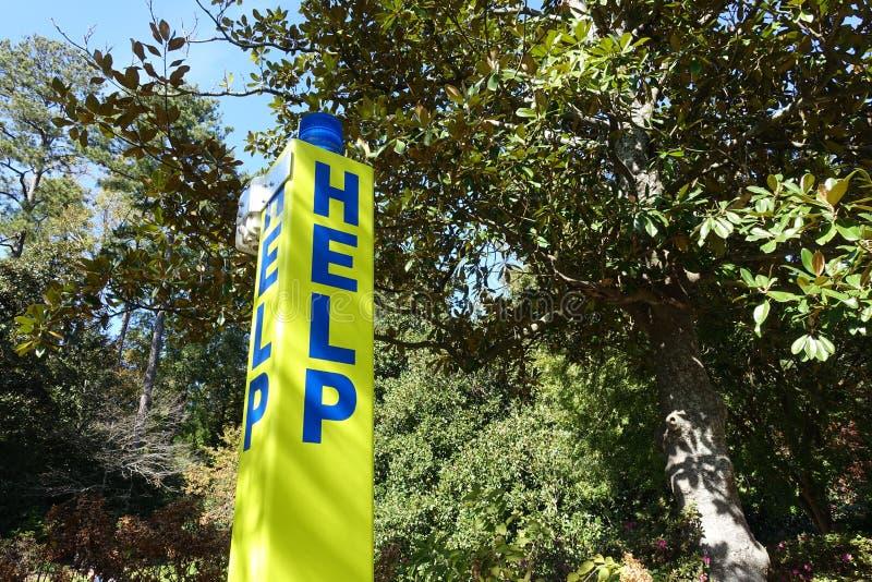 Blue Light Emergency Phone - HELP. Blue Light Emergency Phone Pole on a Campus - HELP royalty free stock photos