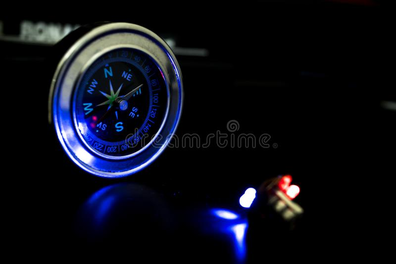 Blue light failing on Silver compass. stock image