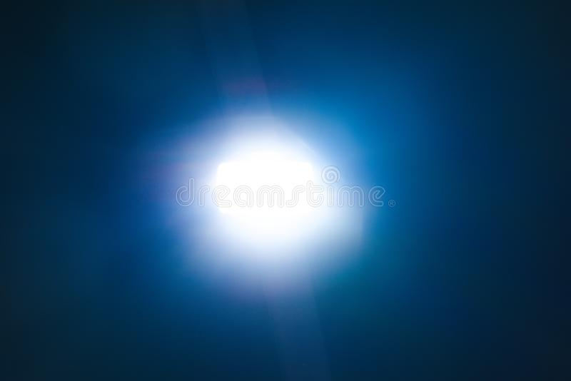 Blue light flare special effect  on black background , concert lighting stock photo